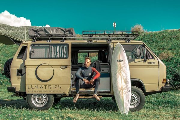 a-surfer-sitting-on-the-side-of-vw-t3-syncro-4x4